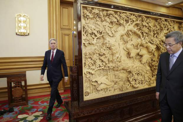 Britain's Chancellor of the Exchequer Philip Hammond, left, arrives to meet Chinese Vice Premier Hu Chunhua at Zhongnanhai in Beijing on Wednesday, June 27, 2018.