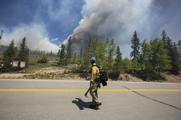 Summit Fire and EMS's firefighter arrives at the scene of a wildland fire in the Wildernest neighborhood Tuesday, June 12, near Silverthorne.
