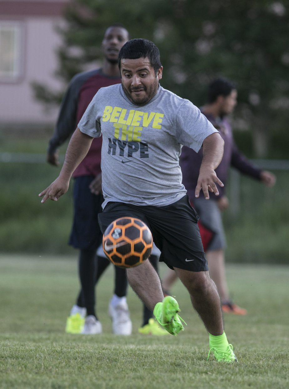 Local resident Kevin Pelin participate in soccer pick up game Tuesday evening, June 26, at the old Silverthorne Elementary School playground.