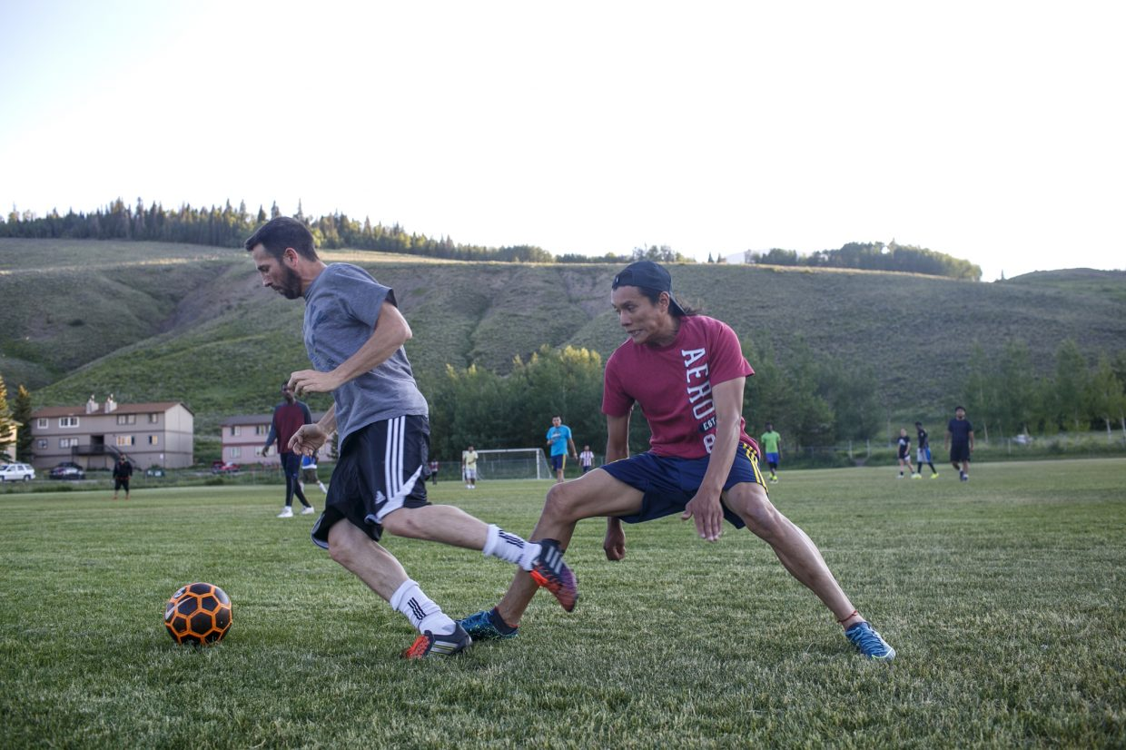 Local residents participate in soccer pick up game Tuesday evening, June 26, at the old Silverthorne Elementary School playground.