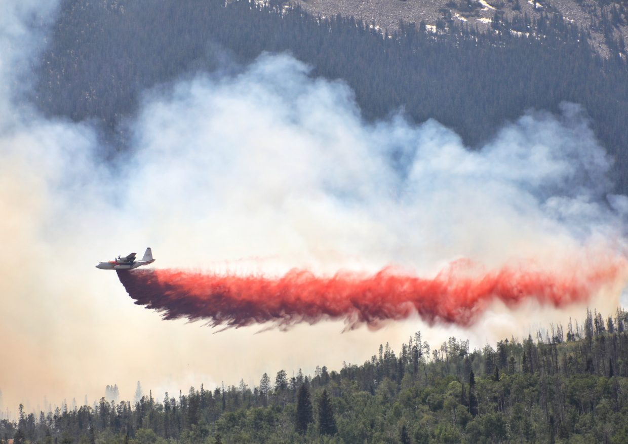 A tanker dumps slurry near the Buffalo Mountain Fire near Silverthorne on Tuesday afternoon.