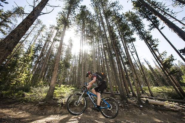 A mountain biker participating in the Breckenridge 100 climbs in the Loop 2 portion of the race Saturday, July 14, in Breckenridge.
