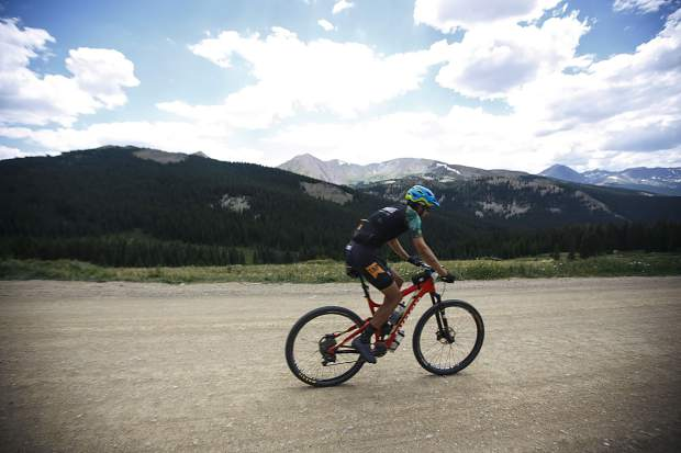 A mountain biker participating in the Breckenridge 100 rides down on Boreas Pass Road Saturday, July 14, in Breckenridge.