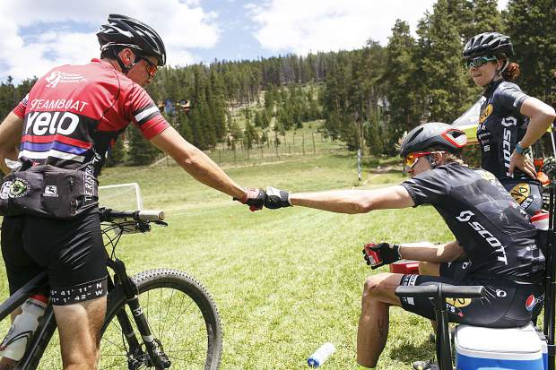 Breckenridge resident and Breck 100 winner Taylor Sheldon, 31, right fist bumps the second place finisher Saturday, July 14, at Carter Park.
