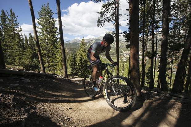 A mountain biker using a fixie gear participating in the Breckenridge 100 climbs in the Loop 2 portion of the race Saturday, July 14, in Breckenridge.