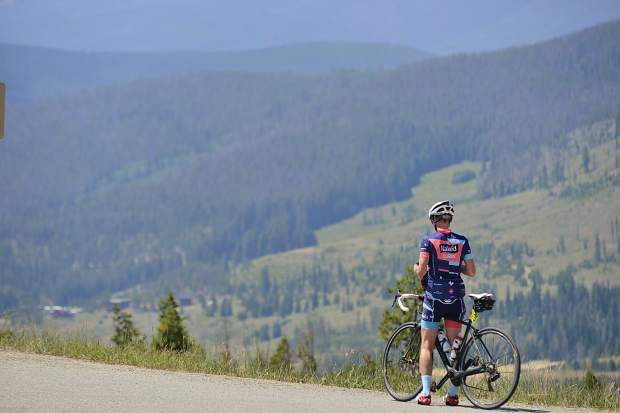 A rider takes a break atop Swam Mountain on Sunday, July 23, during the Courage Classic.