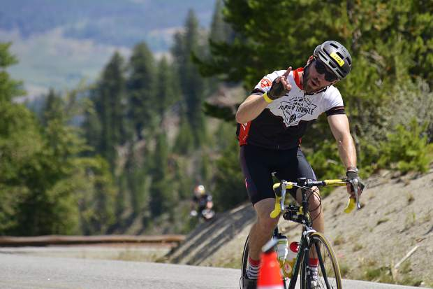 A rider comes to the top of Swam Mountain on Sunday, July 23, during the Courage Classic.