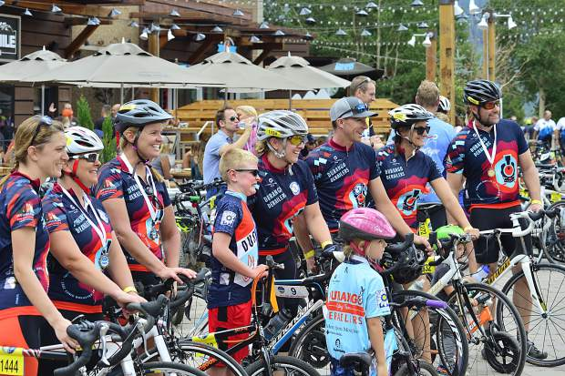 Riders pose for a team photo in the 29th Courage Classic on Sunday, July 23, at Copper Mountain.