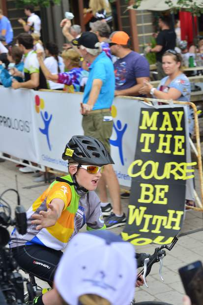 One of the roughly 2,000 participants at last weekend's Courage Classic gets high-fives after crossing the finish line on Sunday. The classic is a two-day bicycle tour starting each day at Copper Mountain that support Children's Hospital Colorado.