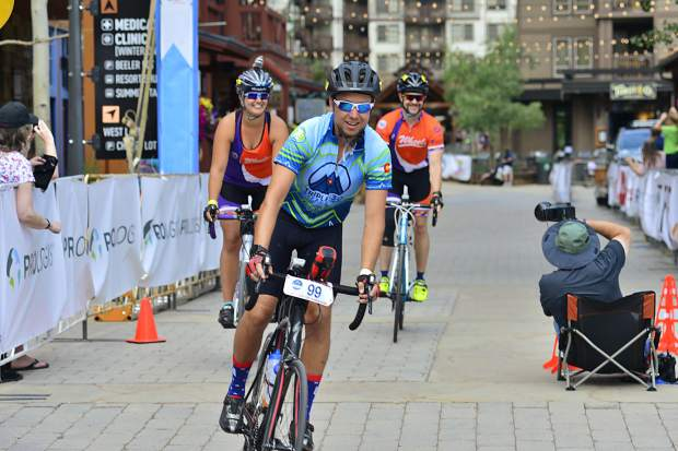 Brandon Nuechterlein, center, his sister Amber Dunlap and her husband Bradley Dunlap finish the 29th Courage Classic on Sunday at Copper Mountain. The two-day bicycle tour is the single-biggest fundraising event for Children's Hospital Colorado and organizers said they believed they'd surpass the $2.8 million goal this time around.