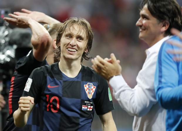 Croatia's Luka Modric celebrates with head coach Zlatko Dalic after advancing to the final during the semifinal match between Croatia and England at the 2018 soccer World Cup in the Luzhniki Stadium in Moscow, Russia on Wednesday, July 11.