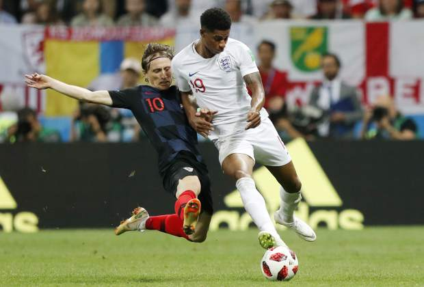 Croatia's Luka Modric, left, and England's Marcus Rashford challenge for the ball during the semifinal match between Croatia and England at the 2018 soccer World Cup in the Luzhniki Stadium in Moscow, Russia on Wednesday, July 11.