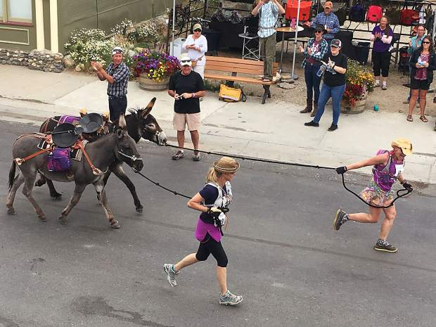 Teams of donkeys and runners head toward Mosquito Pass as they take part in the 70th annual World Championship Pack Burro Race on Sunday in Fairplay. This race is the first in the annual Triple Crown of burro racing in Colorado. The second leg runs in Leadville, August 5th and the third leg is in Buena Vista, August 13.