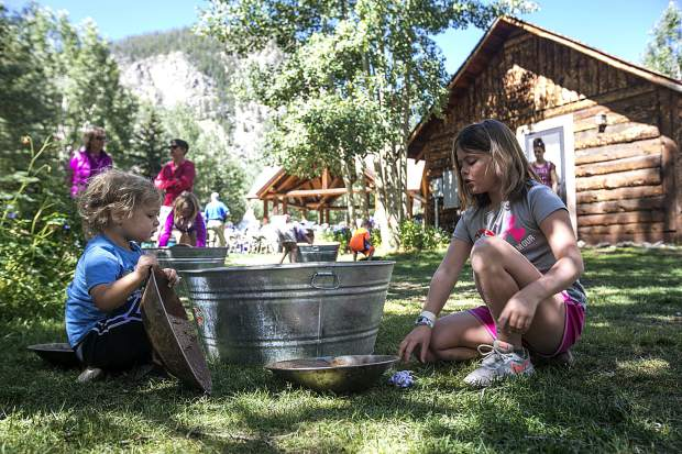 Visiting from Chicago, Ill., Molly Roth, 8, right, and her brother, Sam, 4, interact with the gold panning tools in part of the Frisco Founder's Day event Sunday, July 1, at the Frisco Historic Park and Museum. The museum celebrated its 35th anniversary over the weekend.