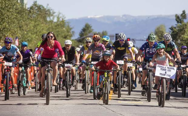 Bicyclists take off from Breckenridge's Main Street for the first 25-mile loop of the annual Fourth of July Firecracker 50 50-mile mountain bike race on Wednesday, July 4.
