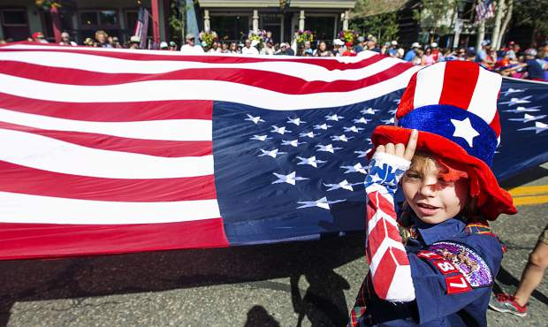 Boy Scout troop member participates in the Independence Day Parade on Wednesday, July 4, on Main Street in Breckenridge.