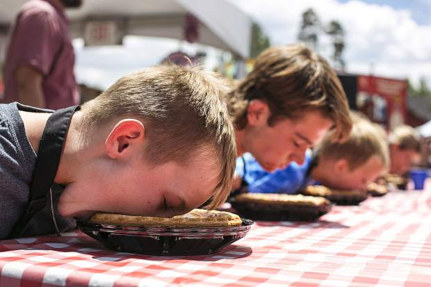 Lane Nichols takes a mouthful in the Pie Eating Contest on Wednesday July 4, in the Arts District of Breckenridge.