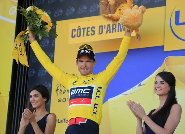 Belgium's Greg van Avermaet wearing the overall leader's yellow jersey celebrates on the podium after the sixth stage of the Tour de France cycling race over 181 kilometers (112.5 miles) with a start in Brest and finish in Mur-de-Bretagne Guerledan, France on Thursday, July 12.