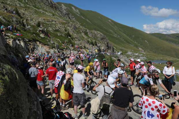 Britain's Geraint Thomas, wearing the overall leader's yellow jersey, climbs Col de Croix de Fer pass during the twelfth stage of the Tour de France cycling race, over 175.5 kilometers (109 miles) with start in Bourg-Saint-Maurice Les Arcs and Alpe d'Huez, France, on Thursday July 19.
