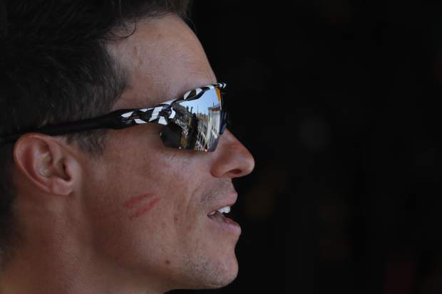 Sylvain Chavanel of France bears the lipstick marks of a kiss of one of the podium hostesses after signing the start list of the eighteenth stage of the Tour de France cycling race over 171 kilometers (106.3 miles) with start in Trie-sur-Baise and finish in Pau, France on Thursday.