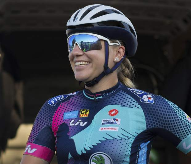 Tetiana Kalachova, a member of female team of amateur cyclists which is completing the Tour de France route to promote the return of the women's Tour, smiles as she poses for a picture in Carcassonne, France on Monday.
