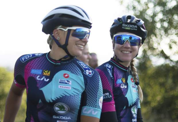 Tetiana Kalachova, left, and Christine Michelet, members of the female team of amateur cyclists completing the Tour de France route to raise awareness for women's cycling and promote the return of the women's Tour, in Carcassonne, France on Monday.