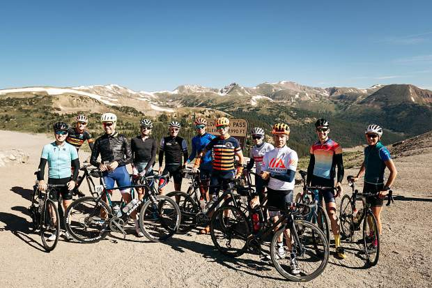 Competitors taking part in the 2018 Mavic Haute Route Rockies cycling tour pose for a photo at the summit of Loveland Pass on Thursday.