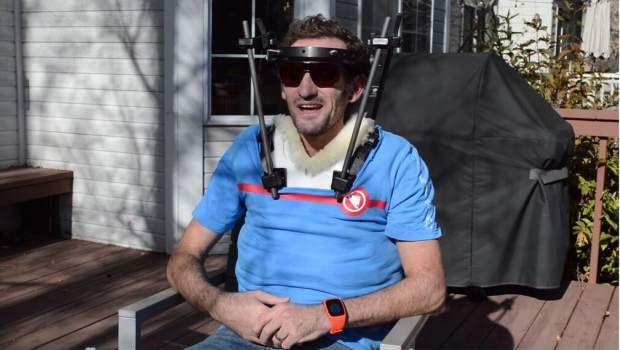 This November 2017 image provided by On shows Tim Don outside his home in Boulder. A few days before the 2017 Ironman world championships in Hawaii, the British-born triathlete was out on a training ride when he got hit by a truck. For three months, the 40-year-old world-record holder wore a halo to stabilize his broken neck. Nicknamed