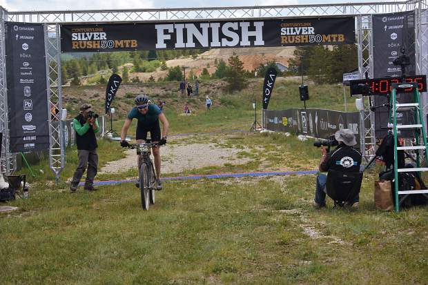 Breckenridge's Sam O'Keefe crosses the finish line at Saturday's Leadville Race Series Silver Rush 50 mountain bike race, in which he took second overall with a time of 4:02:36.