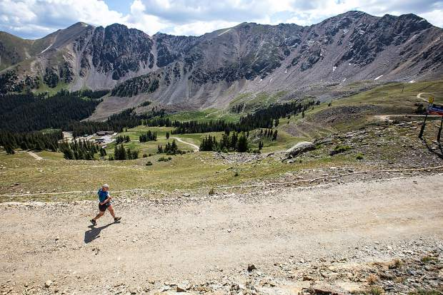 Runners traverse Arapahoe Basin Ski Area on Sunday as part of the ski area's first race of this summer's trail running series, a 4.9-mile race from the base area's Mountain Goat Plaza to the top of Pallavicini and back down.
