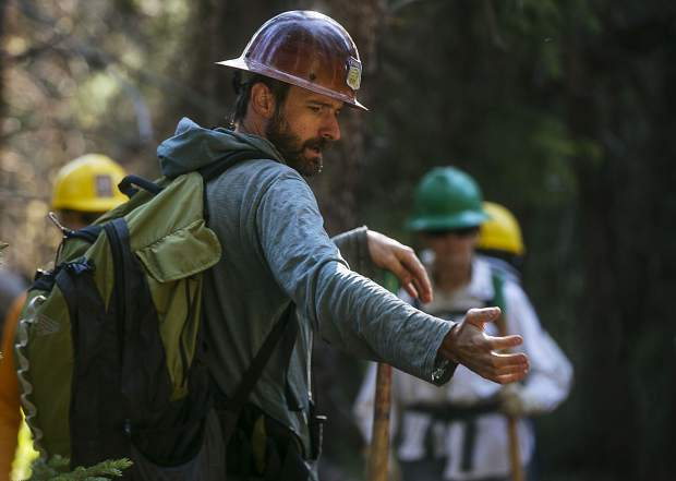 Doozie Martin, Programs Manager, gives instructions for the volunteers to rehabilitate the forest Friday, July 6, along Peru Creek near Montezuma.