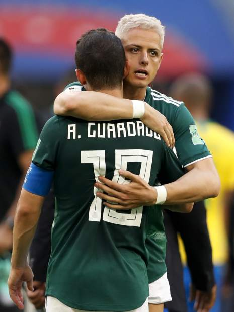 Mexico's Javier Hernandez embraces teammate Andres Guardado at the end of their 0-2 loss against Brazil during a Round of 16 match at the 2018 soccer World Cup in the Samara Arena, in Samara, Russia on Monday, July 2.