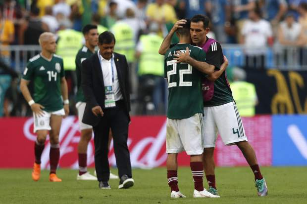 Mexico's Rafael Marquez, right, hugs teammate Hirving Lozano after the Round of 16 match between Brazil and Mexico at the 2018 soccer World Cup in the Samara Arena, in Samara, Russia on Monday, July 2.