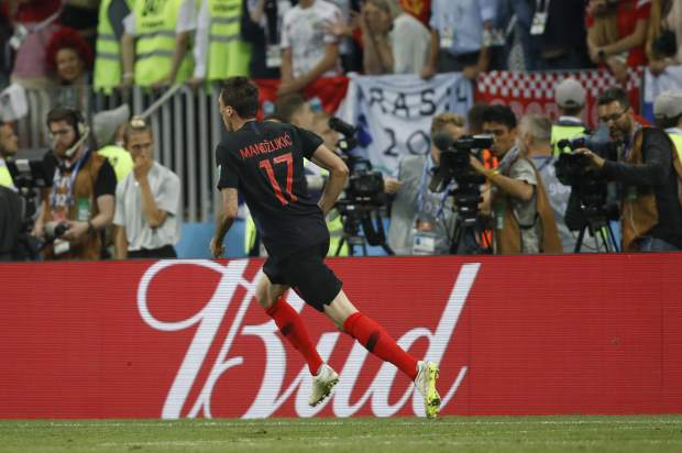 Croatia's Mario Mandzukic celebrates after scoring his side's second goal during the semifinal match between Croatia and England at the 2018 soccer World Cup in the Luzhniki Stadium in Moscow, Russia on Wednesday, July 11.