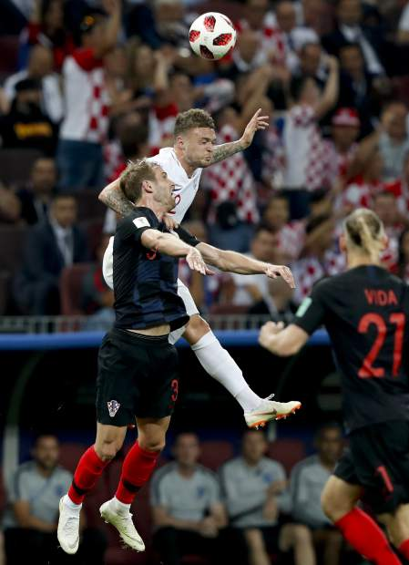 England's Kieran Trippier, right, challenges for the ball with Croatia's Ivan Strinic during the semifinal match between Croatia and England at the 2018 soccer World Cup in the Luzhniki Stadium in Moscow, Russia on Wednesday, July 11.