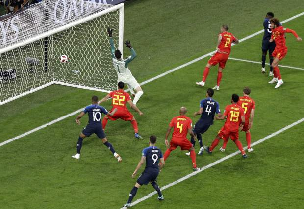 France's Samuel Umtiti, second from right, scores against Belgium in St. Petersburg Stadium on Tuesday.
