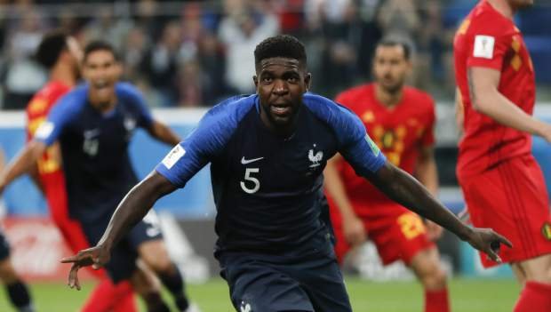 France's Samuel Umtiti celebrates after scoring his side's first goal of the game during the semifinal match between France and Belgium at the 2018 soccer World Cup in the St. Petersburg Stadium in, St. Petersburg, Russia on Tuesday, July 10.