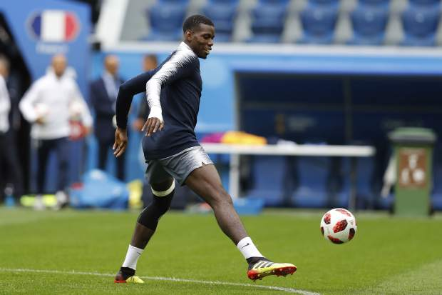 France's Paul Pogba controls the ball during an official training session on the eve of his and France's semifinal against Belgium at the 2018 soccer World Cup in St. Petersburg, Russia on Monday, July 9.