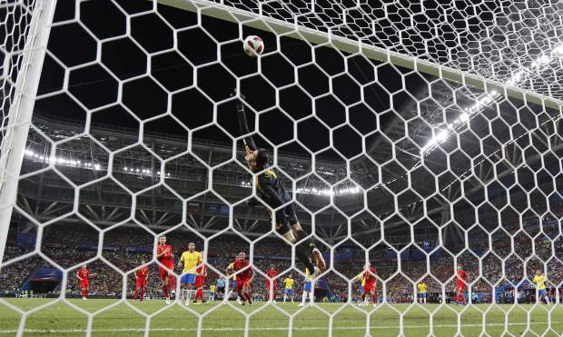 Belgium goalkeeper Thibaut Courtois saves a shot from Brazil's Neymar during the quarterfinal match between Brazil and Belgium at the 2018 soccer World Cup in the Kazan Arena, in Kazan, Russia on Friday, July 6.