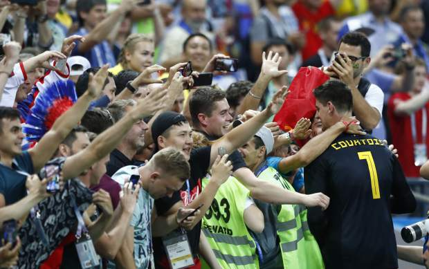 Belgium goalkeeper Thibaut Courtois celebrates with his team's fans after defeating Brazil in the quarterfinal match between Brazil and Belgium at the 2018 soccer World Cup in the Kazan Arena, in Kazan, Russia on Friday, July 6.
