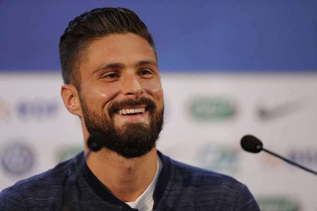 France's Olivier Giroud smiles as he answers journalists' questions during a press conference at the 2018 soccer World Cup in Istra, Russia on Sunday, July 8.