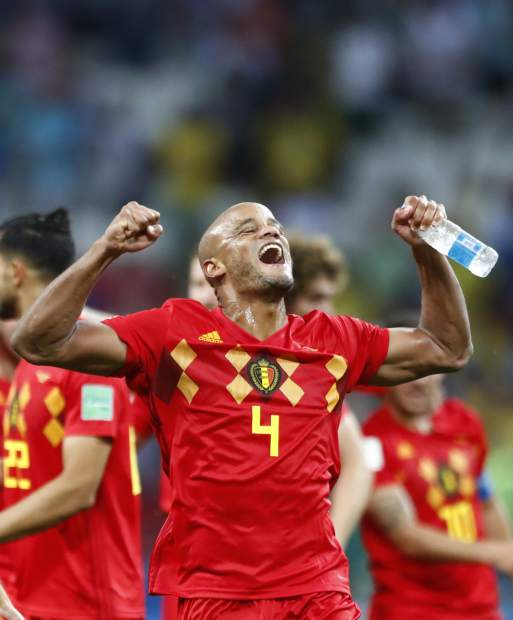 Belgium's Vincent Kompany celebrates toward his team's supporters after defeating Brazil in the quarterfinal match between Brazil and Belgium at the 2018 soccer World Cup in the Kazan Arena, in Kazan, Russia on Friday, July 6.