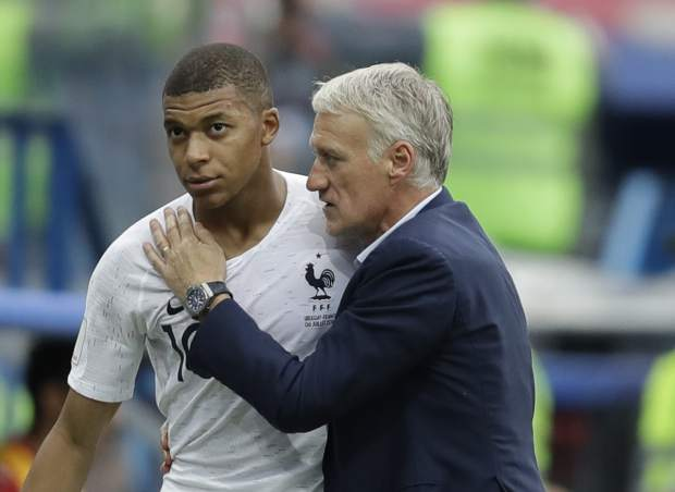 France's Kylian Mbappe, left, is embraced by France head coach Didier Deschamps as he leaves the pitch during the quarterfinal match between Uruguay and France at the 2018 soccer World Cup in the Nizhny Novgorod Stadium, in Nizhny Novgorod, Russia on Friday, July 6.