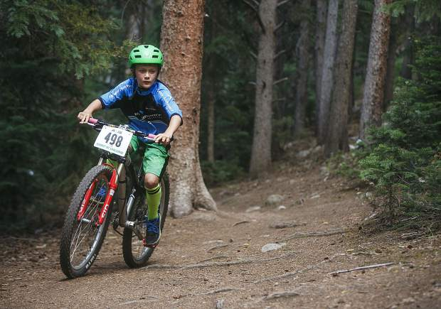Junior boys 10 & under competitor Kiernan Clark of Team Summit rides his mountain bike during the fourth Summit Mountain Challenge mountain bike event of the summer series, the Pennsylvania Gulch Grind, on Wednesday, July 18, in Breckenridge.