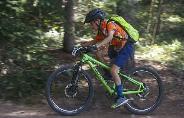A junior participant rides his mountain bike during the fourth Summit Mountain Challenge mountain bike event of the summer series, the Pennsylvania Gulch Grind, on Wednesday, July 18, in Breckenridge.