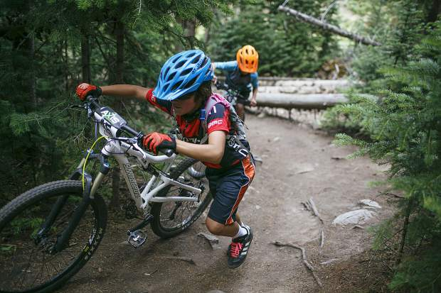 Junior boys 10 & under competitor Tom Hoffman of Team Breck pushes his mountain bike uphill during the fourth Summit Mountain Challenge mountain bike event of the summer series, the Pennsylvania Gulch Grind, on Wednesday, July 18, in Breckenridge.