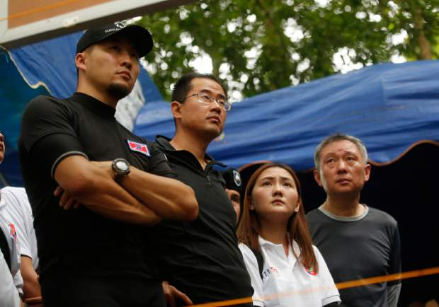 China's rescue team members join in a meeting with U.S. Special Operations Command Pacific Search and Rescue team personnel as they conduct search operation for missing 12 boys and their soccer coach, in Mae Sai, Chiang Rai province, in northern Thailand, Monday, July 2, 2018. Rescue divers are advancing in the main passageway inside the flooded cave in northern Thailand where the boys and their coach have been missing more than a week.
