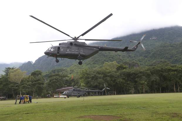 A military transport helicopter prepares to carry drill machine to be used for the search of missing 12 boys and their soccer coach, in Mae Sai, Chiang Rai province, in northern Thailand, Monday, July 2, 2018. Rescue divers are advancing in the main passageway inside the flooded cave in northern Thailand where the boys and their coach have been missing more than a week.