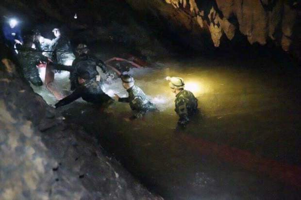 In this handout photo released by Tham Luang Rescue Operation Center, Thai rescue teams walk inside cave complex where 12 boys and their soccer coach went missing, in Mae Sai, Chiang Rai province, in northern Thailand, Monday on July 2. Rescue divers are advancing in the main passageway inside the flooded cave in northern Thailand where the boys and their coach have been missing more than a week.