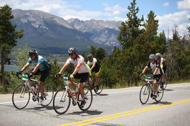 With Buffalo Mountain and the Gore Range in view in the background, cyclists pedal through Dillon on Swan Mountain Road during Saturday's Triple Bypass event. The annual 120-mile bike ride formore than 4,000 cyclists returned this year after wildfires cancelled the tour in 2017, with participants traverssing over several mountain passes east to west, from Evergreen to Avon.